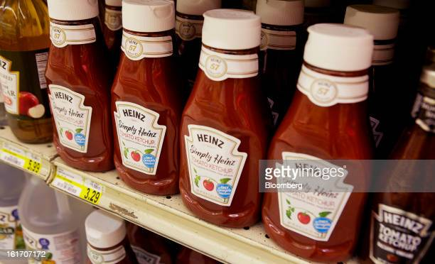 Bottles of HJ Heinz Co ketchup products are displayed on a shelf for sale at grocery store in Pittsburgh Pennsylvania US on Thursday Feb 14 2013...