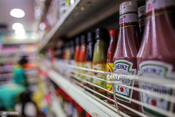 Bottles of HJ Heinz Co ketchup sit on display at a general store in Mumbai India on Sunday July 13 2014 Prime Minister Narendra Modis administration...