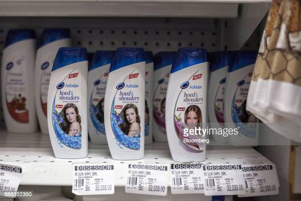 Bottles of 'hoed shouders' shampoo sit on display for sale at a grocery store in Caracas Venezuela on Tuesday Nov 28 2017 In Venezuela there's an...