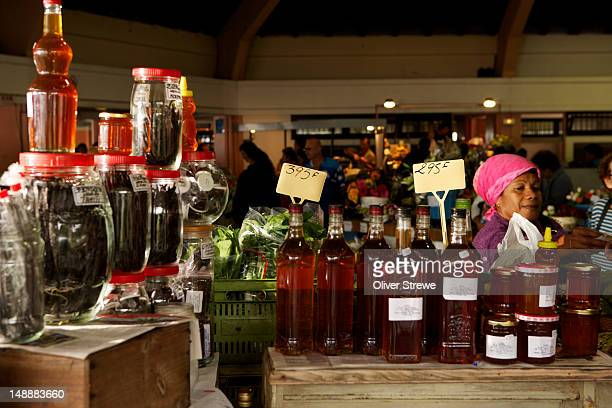 Bottles of honey at market.