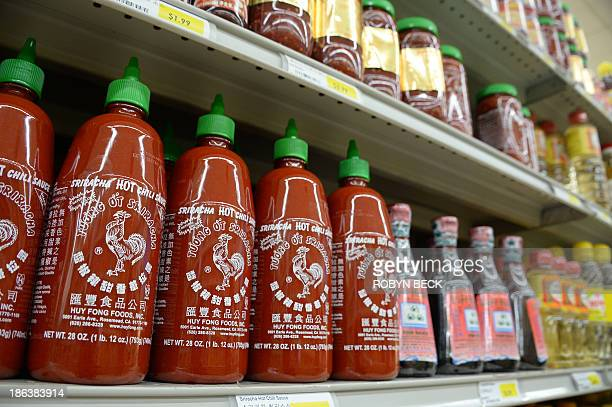 Bottles of Huy Fong brand Sriracha chili sauce are seen for sale at a grocery store in Los Angeles California October 30 2013 A row over spicy smells...