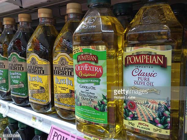 Bottles of imported olive oil and olive oil blends are seen on a supermarket shelf in New York on Monday March 21 2016
