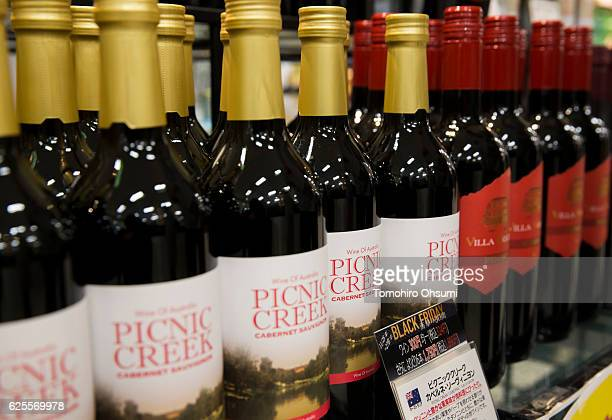 Bottles of imported wines are displayed for sale during the Black Friday sale at an Aeon supermarket on November 25 2016 in Tokyo Japan Japan's...