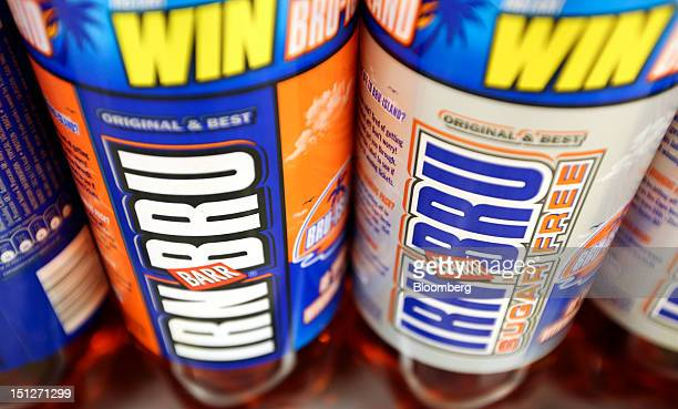 Bottles of Irn Bru soft drink manufactured by AG Barr Plc are seen inside a William Morrison Supermarkets Plc grocery store in Erith UK on Wednesday...