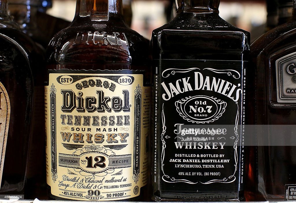 Bottles of Jack Daniel's and George Dickel whiskey are displayed on a shelf at Marin Beverage Outlet on June 11, 2014 in San Rafael, California. A battle is heating up between the owners of rival whiskey brands Jack Daniel's and George Dickel who are fueding over who can label their product as authentic Tennessee style whiskey. Jack Daniel's distills and ages their whiskey in Tennessee while George Dickel distills in Tennessee and ages in Kentucky.