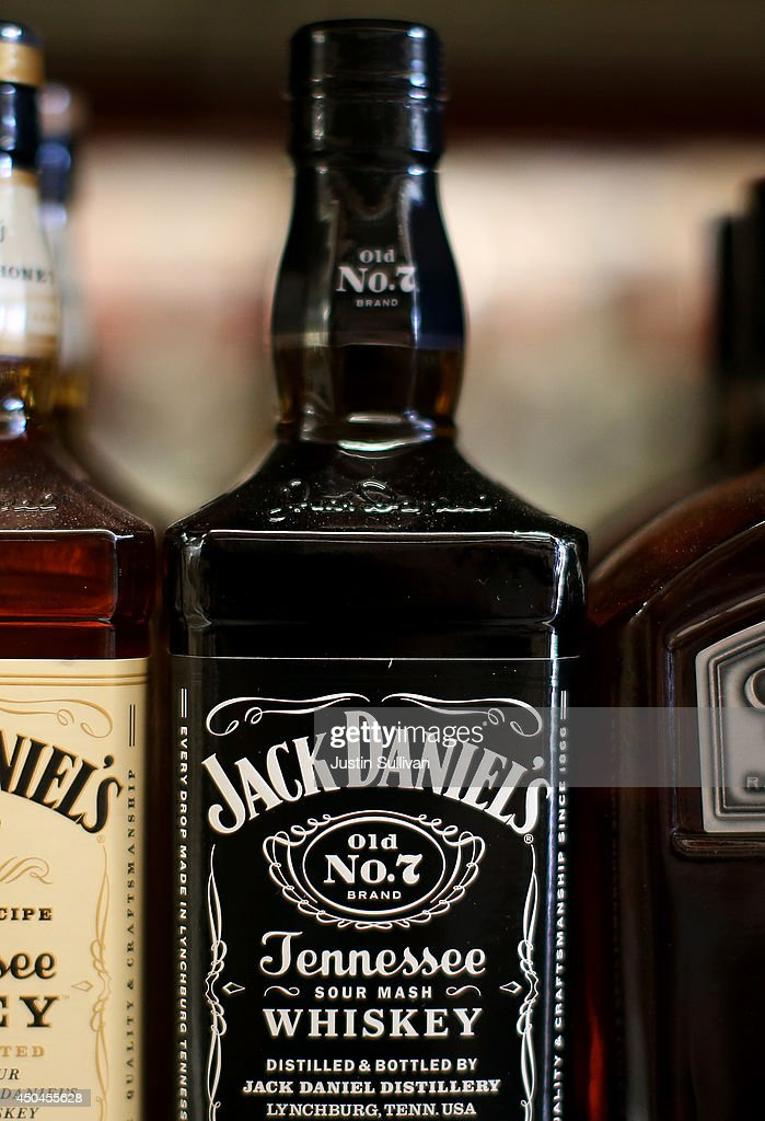 Bottles of Jack Daniel's whiskey are displayed on a shelf at Marin Beverage Outlet on June 11, 2014 in San Rafael, California. A battle is heating up between the owners of rival whiskey brands Jack Daniel's and George Dickel who are fueding over who can label their product as authentic Tennessee style whiskey. Jack Daniel's distills and ages their whiskey in Tennessee while George Dickel distills in Tennessee and ages in Kentucky.