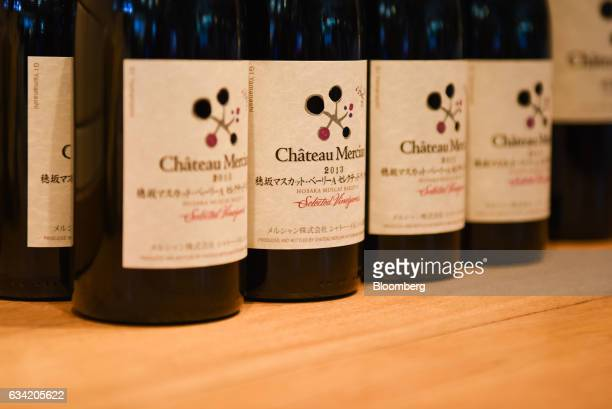 Bottles of Japanese wine sit on display at Chateau Mercian Tokyo Guest Bar in Tokyo Japan on Monday Feb 6 2017 Sake made from fermented rice is the...