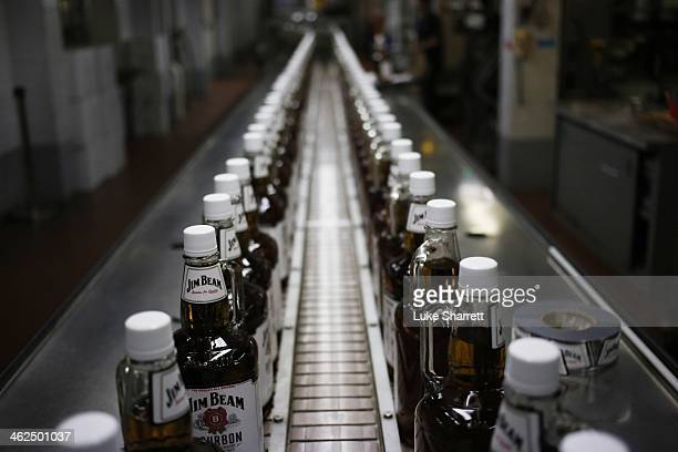 Bottles of Jim Beam Bourbon make their way down a conveyor belt inside the bottling plant at the Jim Beam Bourbon Distillery on January 13 2014 in...