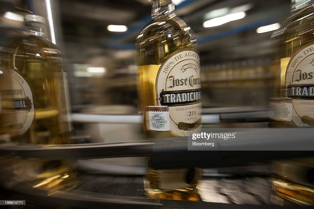 Bottles of Jose Cuervo Tradicional move along the production line at the Tequila Cuervo La Rojena S.A. de C.V. bottling factory in Guadalajara, Mexico, on Thursday, Nov. 22 2012. There are more than 200 types of agave in Mexico, but use of the blue agave plant was made compulsory in the last century to the issuance of the Official Mexican Standard for Tequila production. Photographer: Susana Gonzalez/Bloomberg via Getty Images