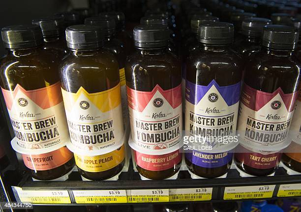 Bottles of kombucha a fermented tea that originated in China are seen for sale at a store in Washington DC August 12 2015 AFP PHOTO / SAUL LOEB