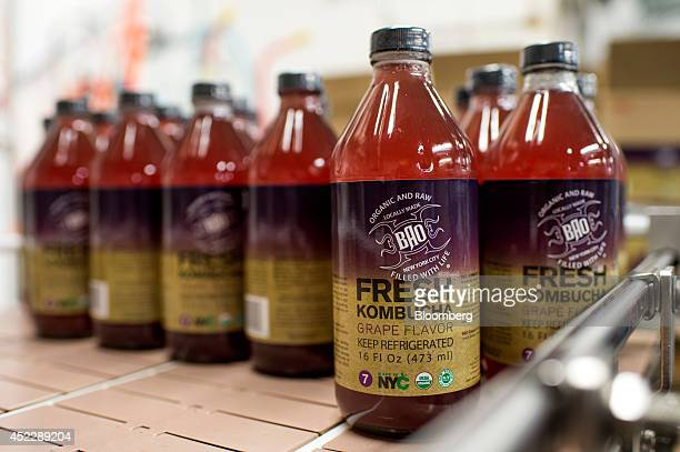Bottles of kombucha are labeled at BAO Food and Drink a manufacturer of organic fermented foods which is located in the Organic Food Incubator in...