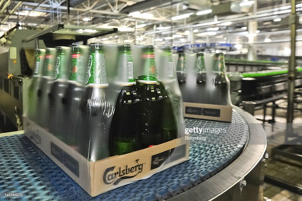 Bottles of lager are packaged for distribution at the Carlsberg A/S production plant in Kiev, Ukraine, on Wednesday, March 14, 2012. Sales in the Ukraine were 'significantly higher,' helped by better economic conditions and the recent introduction of premium beers, while the U.K. saw 'continuing strong growth,' the brewer said. Photographer: Vincent Mundy/Bloomberg via Getty Images