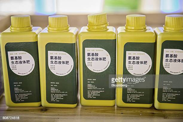 Bottles of liquid fertilizer made from pig excrement sit on display in a visitor center at the Jia Hua antibiotic-free pig farm in Tongxiang, China,...