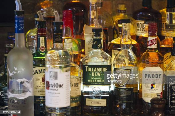 Bottles of liquor are displayed behind the bar at Bloom's Tavern in New York, U.S., on Wednesday, June 24, 2020. Bars across the U.S. Reeling from...