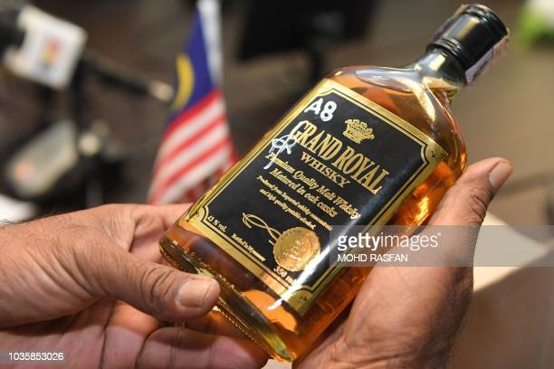 A bottles of liquor seized in police operations are displayed during a press conference by the Royal Malaysia police in Kuala Lumpur on September 19...