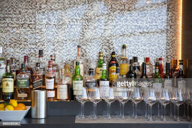 Bottles of liquor sit at the bar inside the American Airlines Group Inc Flagship First Dining room at John F Kennedy International Airport in New...