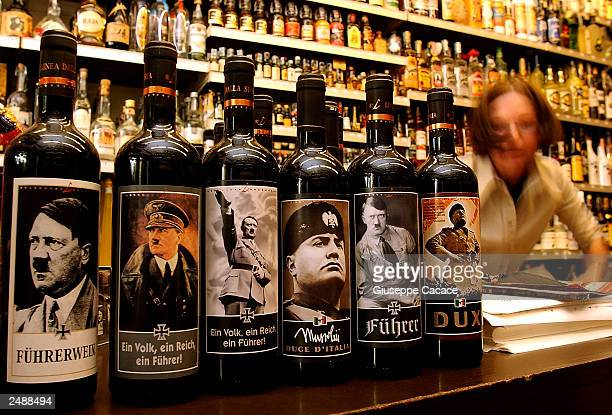 Bottles of 'Lunardelli Wine' with labels depicting Nazi leader Adolf Hitler and facist dictator benito Mussolini are displayed in a wine shop...