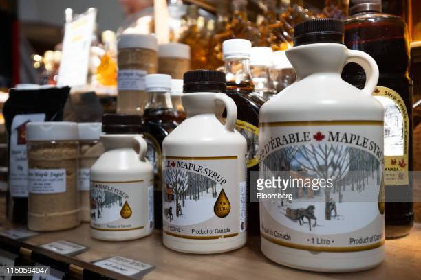 Bottles of maple syrup are displayed for sale at the Granville Island Public Market in Vancouver British Columbia Canada on Sunday June 2 2019...