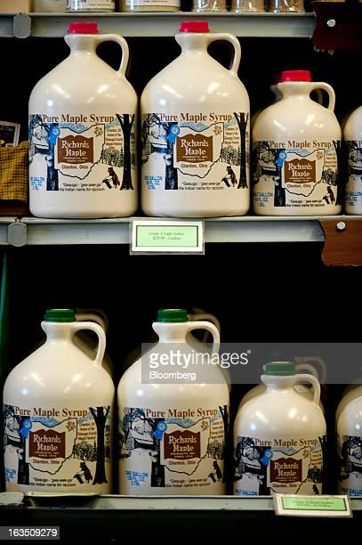 Bottles of maple syrup sit on display in the retail shop at Richards Maple Products in Chardon Ohio on Saturday March 9 2013 Grade A syrup trades...