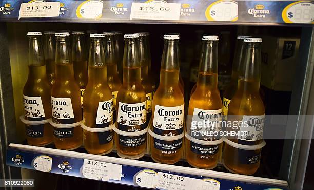Bottles of Mexican Corona beer are pictured in a supermarket in Mexico city on September 28 2016 BelgianBrazilian brewer AB InBev savoured its status...