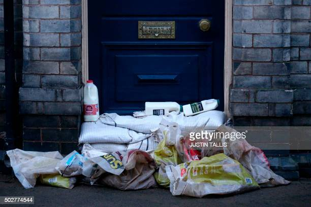 TOPSHOT Bottles of milk delivered to a property are left on top of sandbags placed as defences in the aftermath of flooding in York northern England...