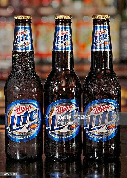 Bottles of Miller Light beer are arranged on a bar in New York Wednesday May 2007 SABMiller Plc the brewer of Peroni Nastro Azzurro lager aims to...