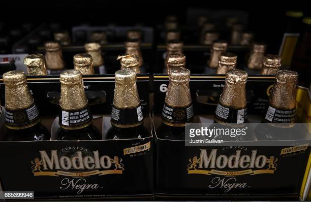 Bottles of Modelo beer are displayed on the a shelf at a supermarket on April 6 2017 in San Rafael California Constellation Brands maker of popular...