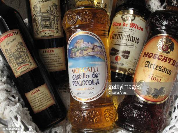 Bottles of muscatel sweet wine and vermouth home for sale in a shop of traditional products of Peniscola and nearby areas Castellon Valencian...
