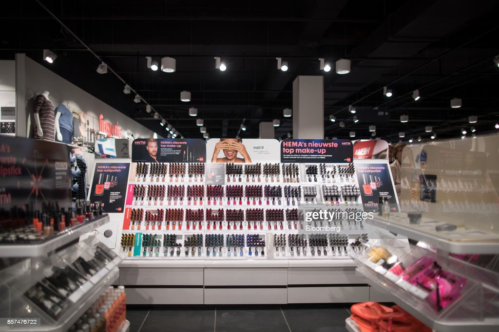 Bottles of nail varnish sit on a cosmetics display inside a