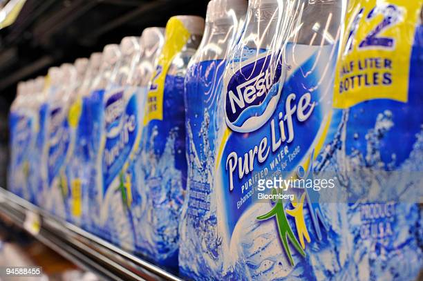 Bottles of Nestle Pure Life water sit on a market shelf in Norcross Georgia US on Jan 22 2008 Tap water is fine for Alice Waters who stopped selling...