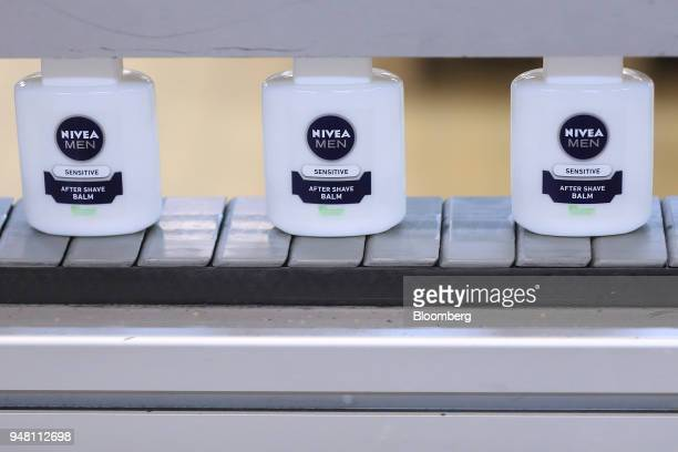 Bottles of Nivea Men aftershave balm move along a conveyor belt inside the Beiersdorf AG factory in Hamburg Germany on Wednesday April 18 2018...