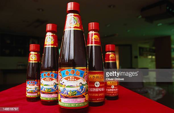 bottles of oyster sauce from the lee kum kee factory, hong kong. oyster sauce features in many chinese dishes. - lee kum kee fotografías e imágenes de stock