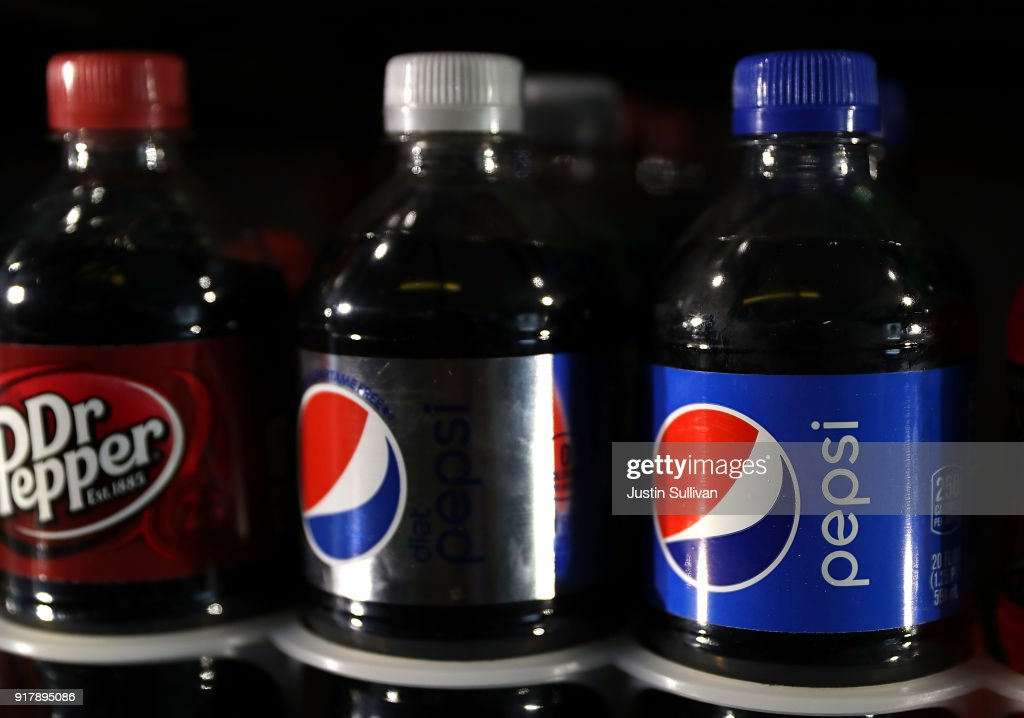 Bottles of Pepsi are displayed on a shelf at a convenience store on February 13, 2018 in San Anselmo, California. PepsiCo reported fourth quarter earnings that beat analyst expectations with revenue of $19.53 billion, above the expected $19.44 billion.