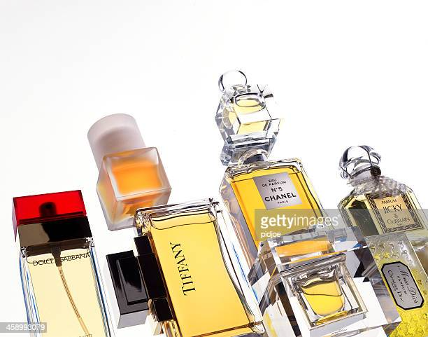 bottles of perfume - christian dior designer label stock pictures, royalty-free photos & images