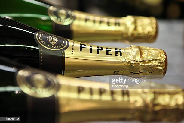 Bottles of Piper-Heidsieck champagne, produced by Remy Cointreau SA, are arranged for a photograph in London, U.K., on Tuesday, Oct. 18, 2011. U.K....