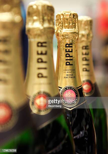 Bottles of Piper-Heidsieck champagne, produced by Remy Cointreau SA, sit on display at a supermarket in London, U.K., on Tuesday, Oct. 18, 2011. U.K....