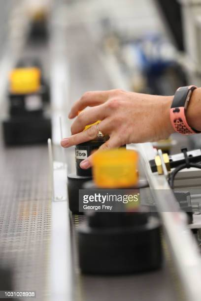 Bottles of prescription drugs are filled as they move down an automated line at the central pharmacy of Intermountain Heathcare on September 10 2018...