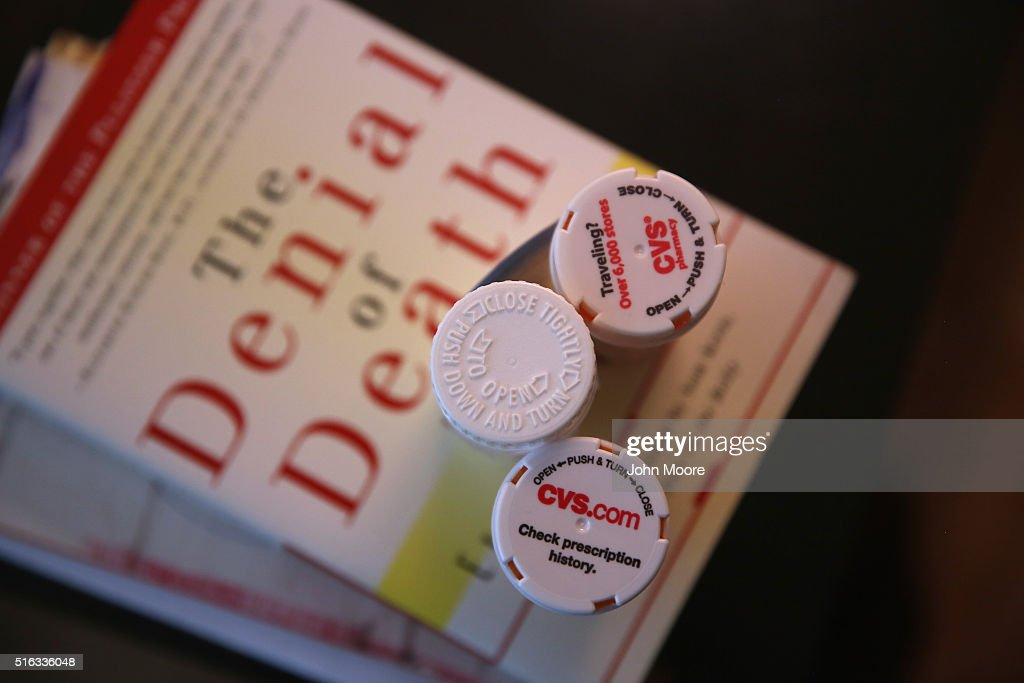 Bottles of prescription medicines stand on reading material in the Manhattan apartment of Youssef Cohen, who has an incurable cancer called mesothelioma on March 16, 2016 in New York City. Cohen, 68, is advocating for the right to choose how and when he will die, proposed in New York State's End of Life Options Act, currently in front of the state legislature. Cohen is a professor of political science at New York University and is currently on sabbatical, due to his illness. He had his first bout with cancer in 2012 and has since undergone chemotherapy, surgery and radiation. He is currently taking immunotherapy infusions of the drug Keytruda in a final effort to fight the disease. The national 'right to die' movement is also known as 'death with dignity,' or called 'physician-assisted suicide' by opponents. It is now completely legal in 4 states, including California, where the new law goes into effect this June. If New York does not pass its legislation in time for Cohen's death, he and his wife say they are prepared to move to Oregon, the first state to make death with dignity legal, in order to insure that he dies without suffering.
