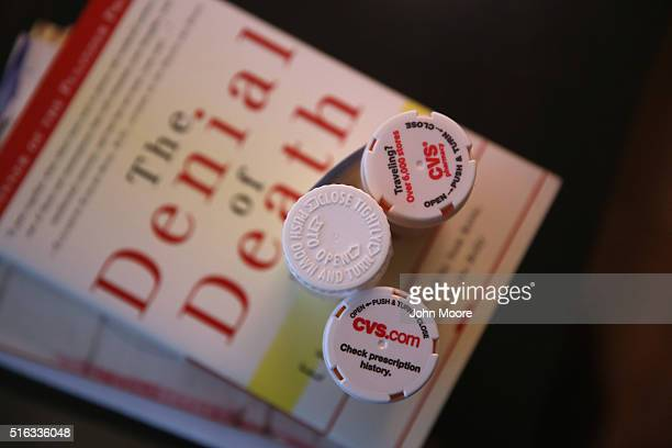 Bottles of prescription medicines stand on reading material in the Manhattan apartment of Youssef Cohen who has an incurable cancer called...