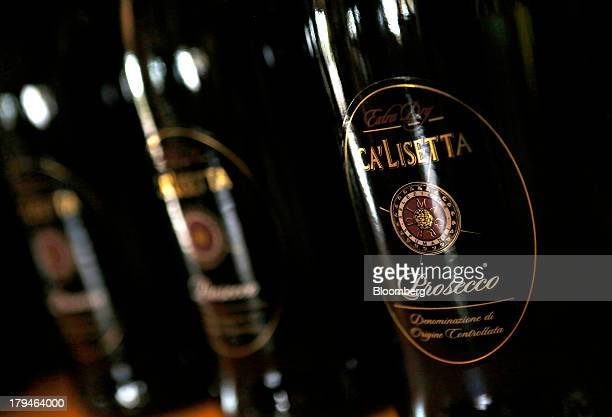 Bottles of Prosecco wine stand displayed for sale at the I Magredi vineyard in Pordenone Italy on Tuesday Sept 3 2013 Italy's Agriculture Ministry...