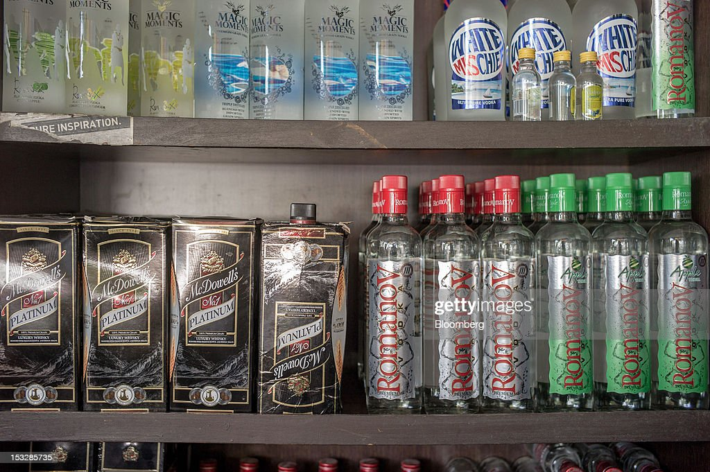 Bottles of Radico Khaitan Ltd Magic Moments vodka clockwise from top left United Spirits Ltd White Mischief and Romanov vodkas and United Spirits Ltd.