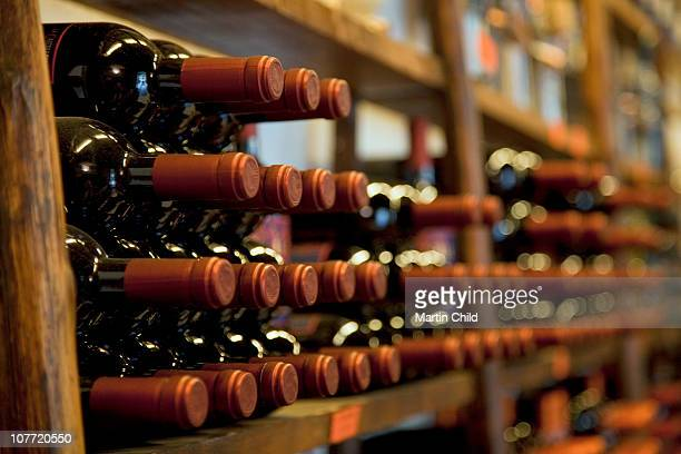 bottles of red wine in rack