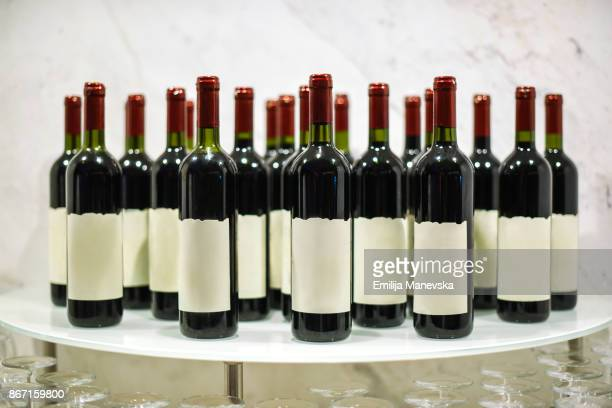 bottles of red wine with blank front label - wine bottle stock pictures, royalty-free photos & images