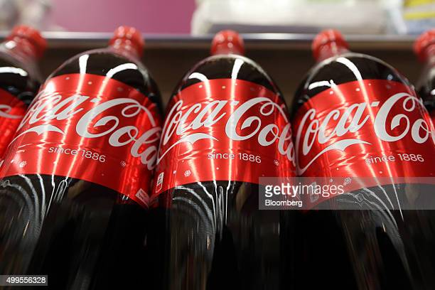 Bottles of regular CocaCola soft drink manufactured by CocaCola Co stand on display at the Tesco Basildon Pitsea Extra supermarket operated by Tesco...