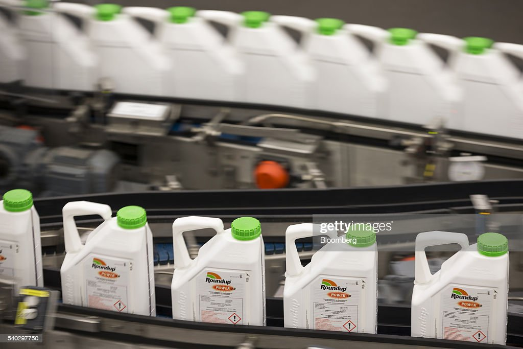 Bottles Of Roundup Weed Killer Move Along The Production Line At Herbicide Manufacturing Facility Operated