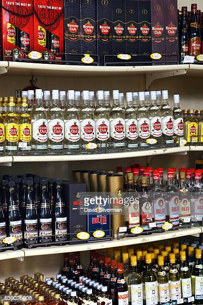 Bottles of rum fill the shelves at a supermarket on December 24 2015 in Santa Clara Cuba Cubans consumes the most rum per capita more than 49 litres...