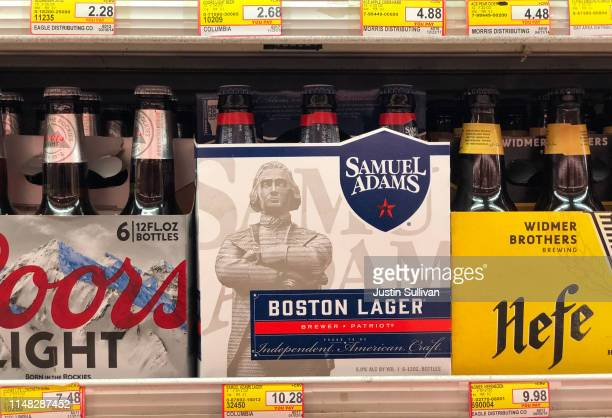 Bottles of Samuel Adams beer are displayed on a shelf at grocery store on May 10 2019 in San Francisco California Boston Beer Company the second...