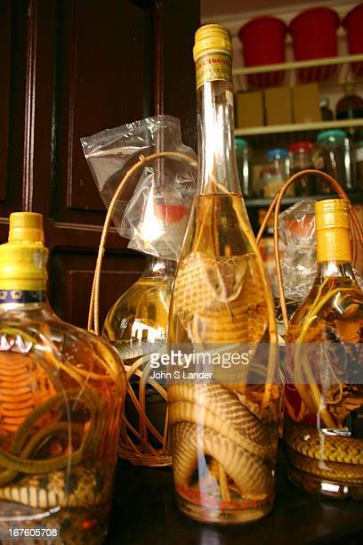 Bottles of snake wine in a herbal medicine shop in the Hanoi Old Quarter near Hoan Kiem lake The Old Quarter has the original street layout and...