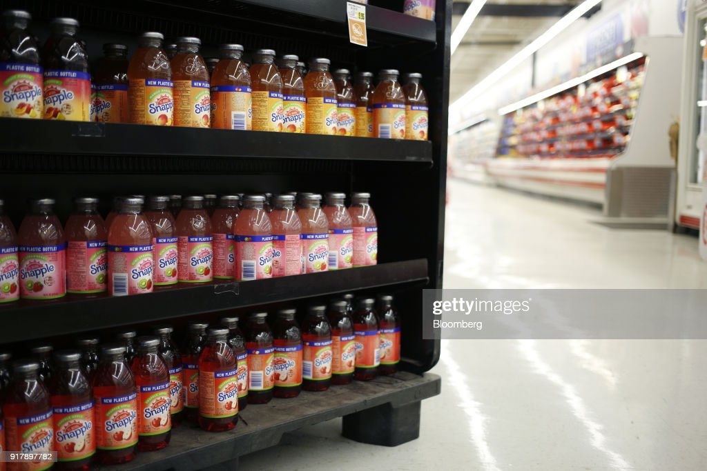 Bottles of Snapple brand beverages sit on display for sale at a grocery store in Louisville, Kentucky, U.S., on Tuesday, Feb. 13, 2018. Dr. Pepper Snapple Group Inc. is scheduled to release earnings figures on February 14. Photographer: Luke Sharrett/Bloomberg via Getty Images