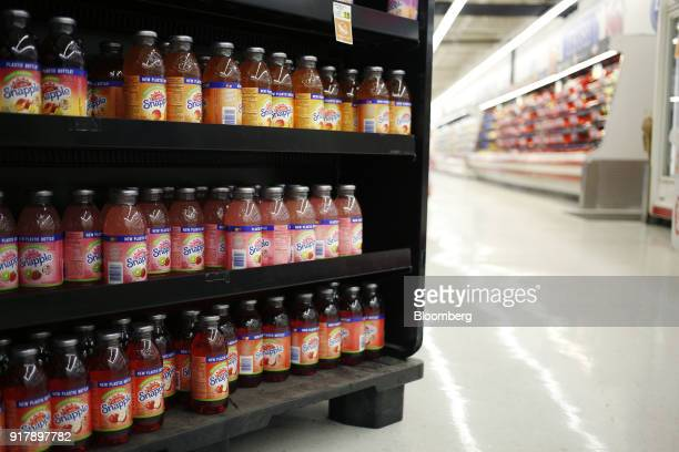 Bottles of Snapple brand beverages sit on display for sale at a grocery store in Louisville Kentucky US on Tuesday Feb 13 2018 Dr Pepper Snapple...